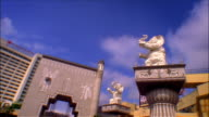 Time lapse low angle view of elephant statues outside the Kodak Theatre at the Hollywood and Highland Center / Los Angeles, California