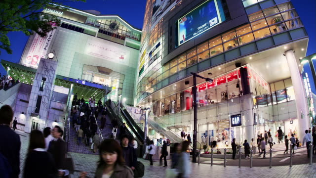 Time lapse low angle view of escalators and shops at Lumine 2 exit from Shinjuku Station / Tokyo, Japan