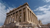 Time lapse low angle wide shot view of the Parthenon with clouds moving overhead / Athens, Greece