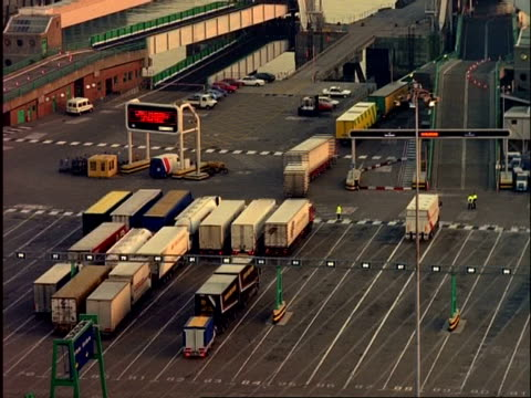 ARCHIVAL Time lapse - MCU Lorries embarking on ferry, Ferry Terminal, Dover, day to evening