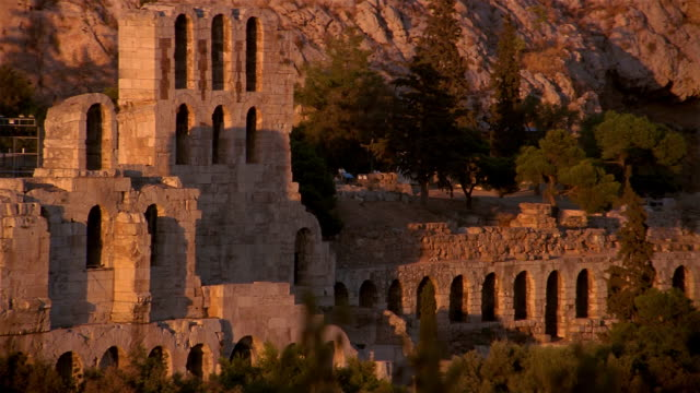 Time lapse medium shot shadows growing larger on Odeum (Theater) of Herodes Atticus / Athens, Greece