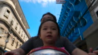 Time Lapse Of Asian Parents Traveling By Motorcycle