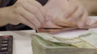 Time Lapse Of Asian Women Counting Money Thai Baht On Her Workplace In Home