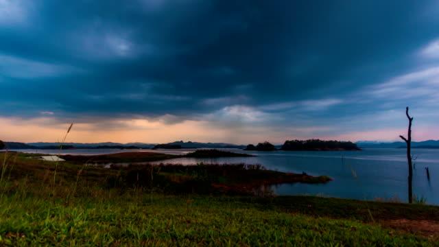 Time lapse of Beautiful sunset on lake and small island