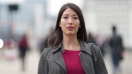 Time lapse of businesswoman on busy street