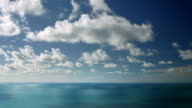 Time lapse of clouds drifting over calm ocean / Pacific Ocean, North Island, New Zealand