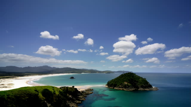 Time lapse of clouds passing over beach / Kaitoke, Great Barrier Island, New Zealand