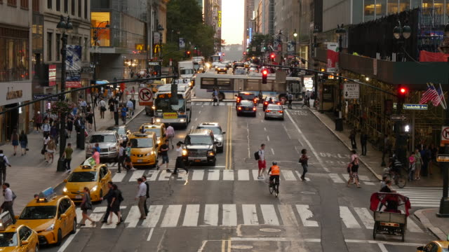 time lapse of crowd of people walking on busy street at rush hour in new york city. urban metropolis lifestyle background