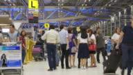 Time Lapse of Crowd walking at Airport terminal at night