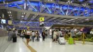 Time Lapse of Crowd walking at Airport terminal during night