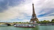 Time lapse of Eiffel Tower and boats on Seine River in Paris.