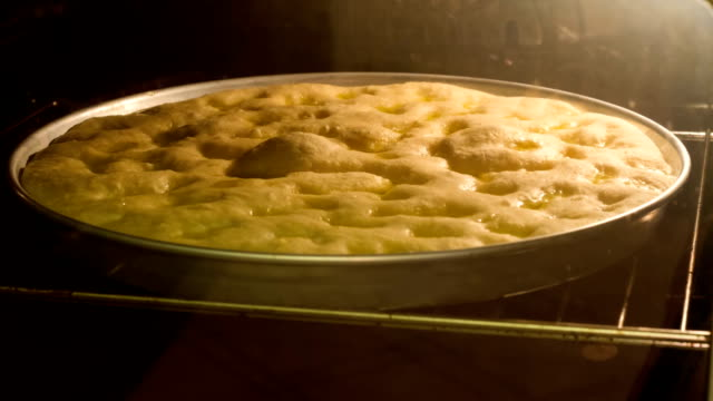 Time lapse of focaccia rising in the oven
