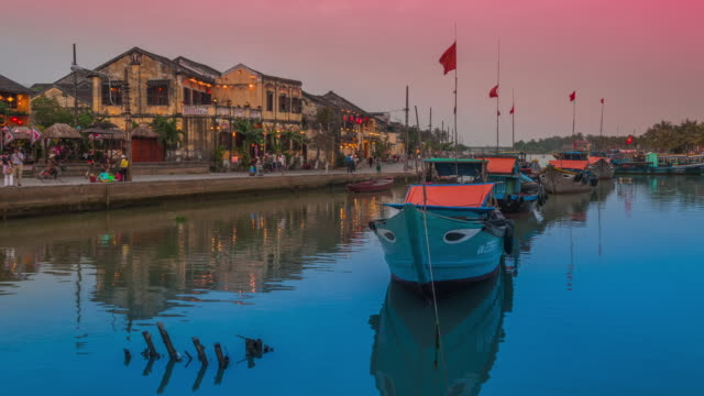 Time lapse of light and lanterns coming on in the centre of  Hoi An, Footage slowly zooms in to focus on building on Bach Dan Street, Hoi An Vietnam