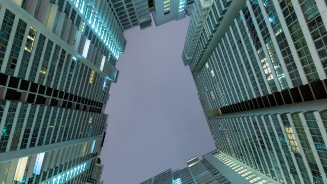 Time Lapse of Malaysia apartment building at night, Tilt down.