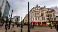 MANCHESTER - CIRCA 2013: Time Lapse of Manchester Library with Tram and people passing in a cloudy day in Manchester