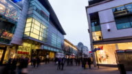 MANCHESTER - CIRCA 2013: Time Lapse of Manchester shopping center with people passing, in a cloudy day in Manchester