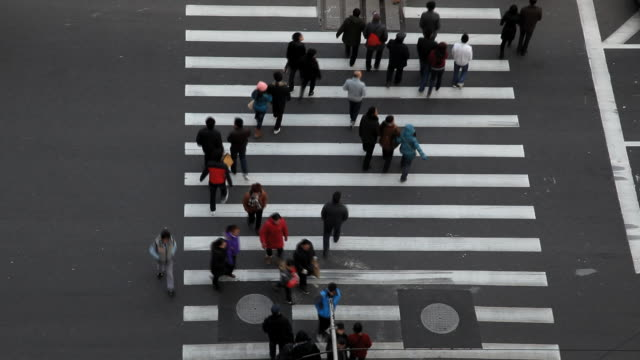 Time lapse of people and vehicles on pedestrian crossing central Shanghai city, Shanghai, China, Asia