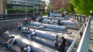 Time Lapse of people sitting in High Line amphitheater, Zoom out