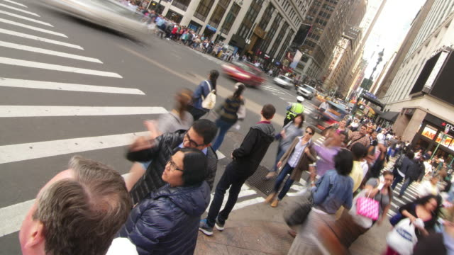 Time Lapse of rushing traffic and people walking in Manhattan, New York City