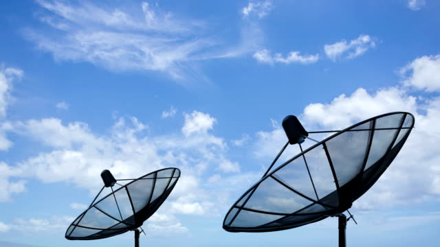 HD time lapse of satellite dish with clouds move