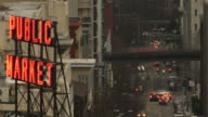 Time lapse of Seattle Pikes Public Market  sign with downtown traffic