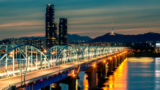 4K Time lapse of Seoul City skyline at Dongjak Bridge and Han river in Seoul, South Korea.