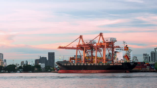 Time lapse of shipping port beautiful dusk and ship loading working