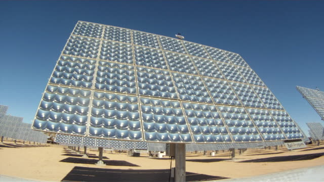 Time Lapse of solar panels on solar farm moving as they track the movement of the sun on a sunny day