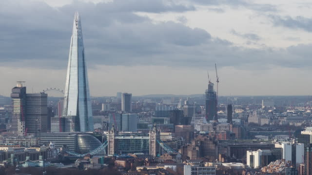 LONDON - CIRCA 2014: Time Lapse of the city of London from a high level roof top, during a cloudy and sunny day