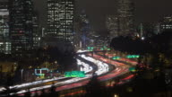 Time lapse of the inner city and traffice on highway 5 in Seattle at night.