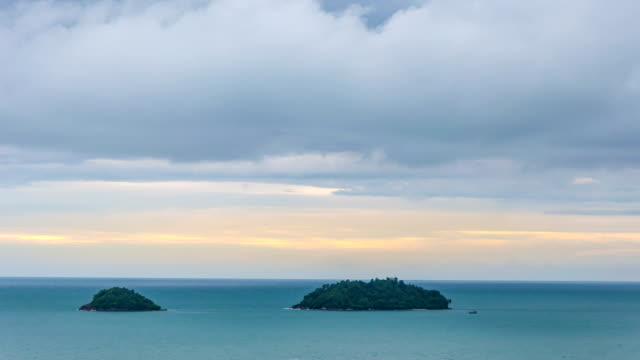 Time lapse of tropical green island ans dramatic sky at dusk