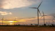 Time lapse of wind turbines on sunset