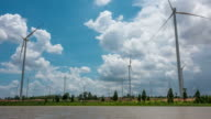 Time lapse of wind turbines with blue sky