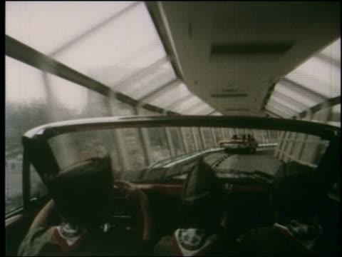 1964 time lapse overtheshoulder car point of view boy scouts riding car amusement park ride at NY World's Fair