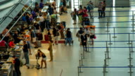 HD Time Lapse : Passengers checking in at the airport