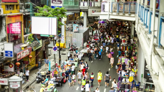 time lapse : people travelling at Silom walking street Bangkok Thailand