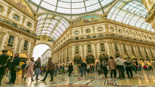 Time Lapse: People walk on galleria Vittorio Emanuele II seen from above of the most popular shopping areas in Milan.