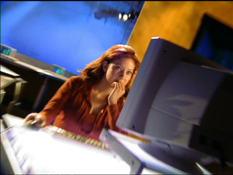 SWISH PAN time lapse redhead woman sitting at computer desk typing + stretching
