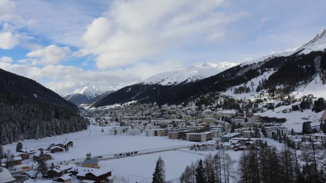 Time lapse sequence mountains and town of Davos at dawn moving clouds changing daylight in Davos Switzerland on Sunday Jan 19 2014 Davos morning time...