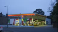 Time lapse sequence shows automobiles and other vehicles passing a gas station operated by Royal Dutch Shell Plc in London UK on Monday April 28 2014