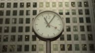 Time lapse sequence shows clockface with time at one o'clock in the afternoon in Canada Square Time lapse sequence shows pedestrians and commuters...