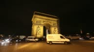 Time lapse sequence shows traffic passing the Arc de Triomphe at night in Paris France on Tuesday Feb 18 2014