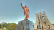 Time lapse shot across a statue of Kwame Nkrumah in the city of Accra.