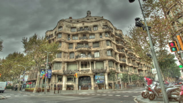 Time lapse shot across the exterior of the Casa Mila building in Barcelona.