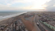Time lapse shot from day to night over a beach in the city of Accra.