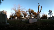 Time lapse shot of a cemetery as the sun sets