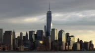 Time lapse shot of One World Trade Center. A helicopter zooms through the shot
