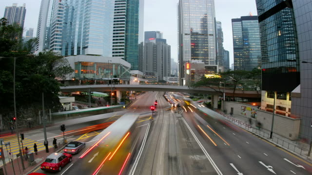 Time lapse shot of traffic on Hennessy Road in Central at dusk / Hong Kong