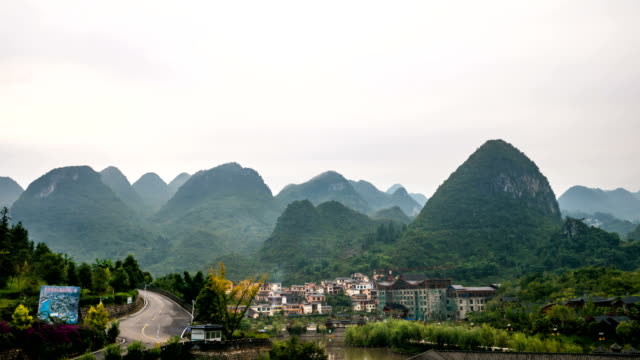 Time lapse shot of Tranquil scene from traditional village in valley, Guizhou province, China