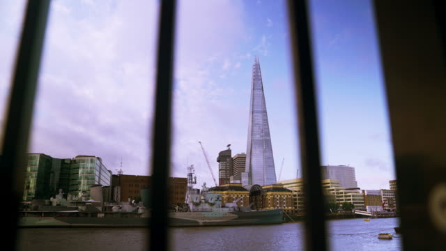 Time lapse shot zooming in through railings onto the Shard.